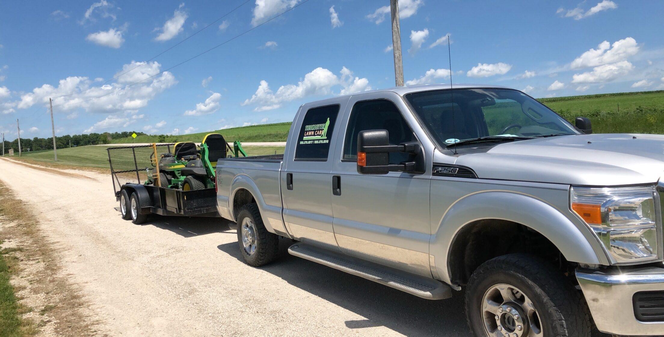 Lawn mower on trailer of a Tieskoetter Lawn Care truck